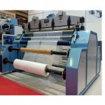 AK1750 PERFORATED AND SINGLE CUTTING ROLL BAG MACHINE ( AUTOMATIC LOADING SYSTEM )